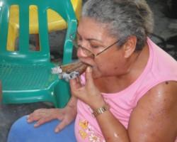 Farides smoking the cigars
